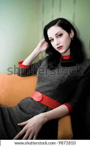 Model shot in the retro-vintage style, set: hotel room. - stock photo