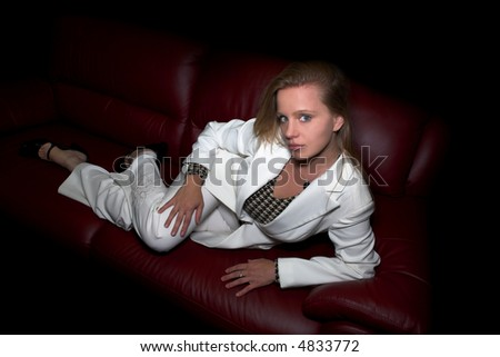model shot posing in studio on couch