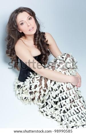 Model sitting in a studio - stock photo