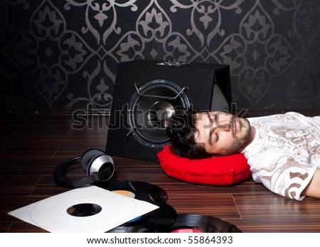 Model sleeping on the floor - stock photo