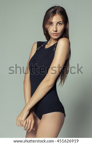 model tests of young pretty girl over grey background