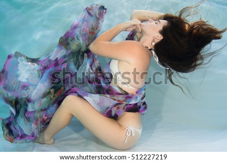 Model Underwater wearing crochet bikini