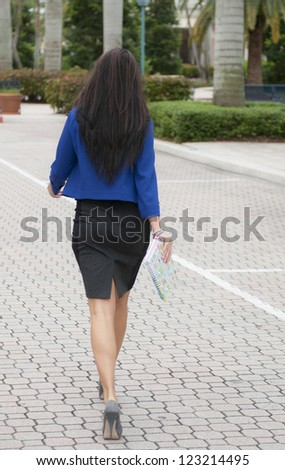 Model walking away from the camera. - stock photo