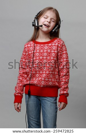 Model wearing red christmas sweater is singing - stock photo