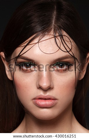 Model with Beauty face makeup.Big Lips. Eyelashes extensions. Perfect Make-up closeup. Foundation. Cosmetic Eyeshadows, eyebrows. Beauty Girl with Perfect Skin. Eyelashes. Makeover  - stock photo