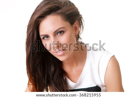 model with brown hair posing on white background