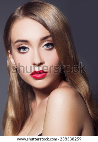 Model with chic lips make-up with red lips - stock photo
