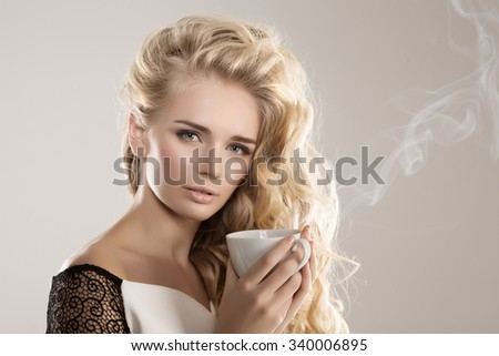Model with coffee cup, mug in coffee shop. Fashion Woman, tea party time. Green Black. Blonde girl, tea set - stock photo