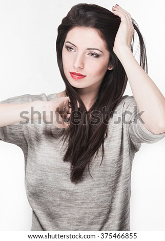 Model with dark hair on a white background