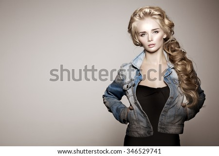 Model with long braided hair. Waves Curls Braid Hairstyle. Hair Salon. Updo. Fashion shiny hair. Woman with healthy hair, girl with luxurious haircut. Hair loss, braiding hair volume. jeans, denim - stock photo
