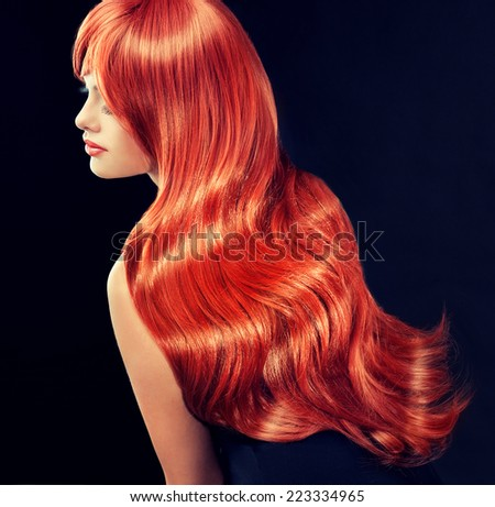 model with long curly red hair - stock photo