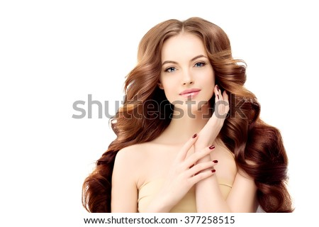 Model with long wavy hair. Waves Curls Hairstyle. Hair Salon. Updo. Fashion model with shiny hair. Woman with healthy hair girl with luxurious haircut. Hair loss Girl with hair volume. Brunette