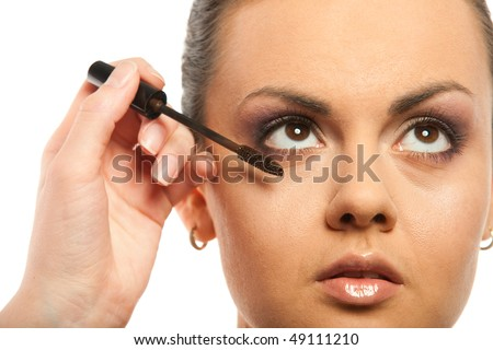 Model with makeup and brush isolated on white
