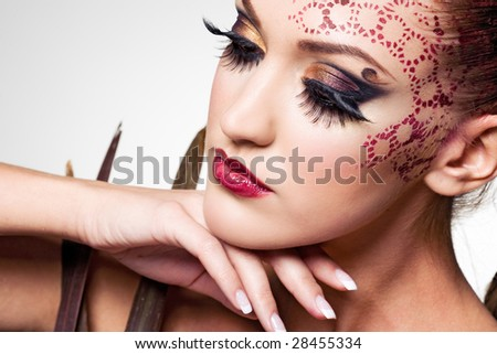 model with ornament on her head - stock photo