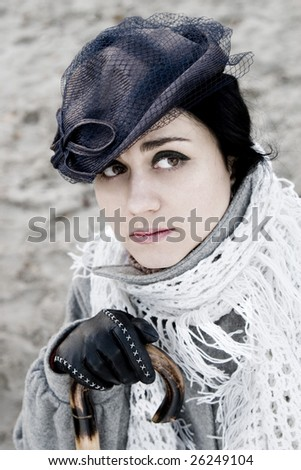 Model with stylish retro hat and scarf. - stock photo
