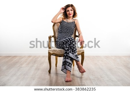 Model woman on vintage armchair