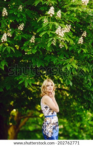 model young  girl under the chestnut - stock photo