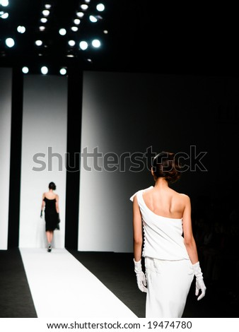 Models on the catwalk during a fashion show. - stock photo