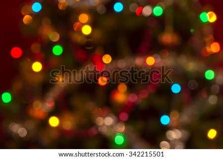 Moderately defocused real Christmas background with small sized colorful bokeh