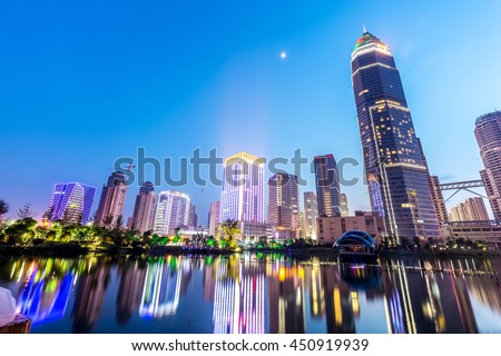 modern abstract office buildings in hangzhou West Lake culture plaza at twilight  - stock photo