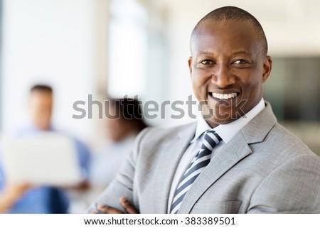 modern african businessman portrait in office - stock photo