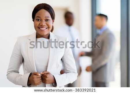 modern african businesswoman in office looking at the camera - stock photo