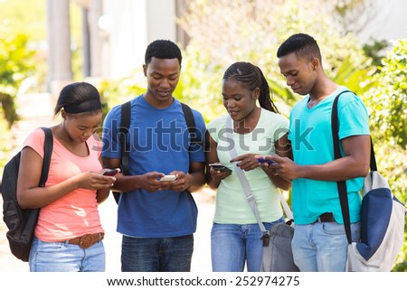 modern african college student using their cell phones - stock photo