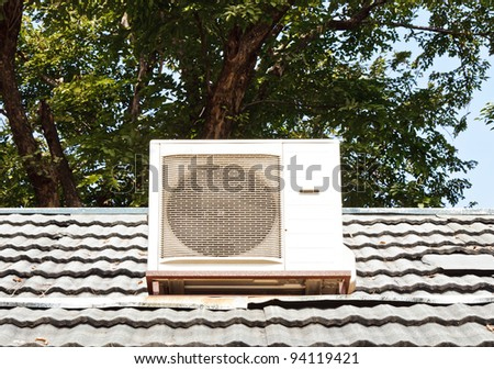 Modern air compressors are located on the roof of shop. - stock photo