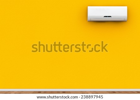 Modern air conditioner on a yellow wall - stock photo