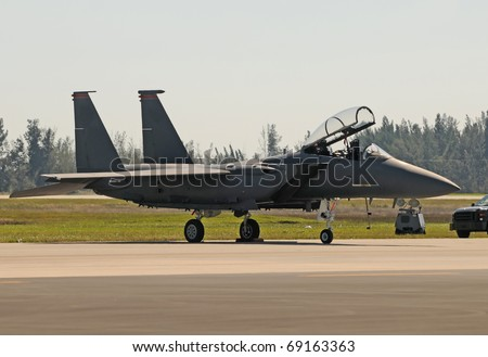 Modern Air Force jet fighter preparing for flight - stock photo