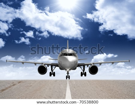 Modern airplane in the runway - stock photo