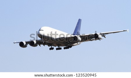 Modern airplane isolated on blue sky - stock photo