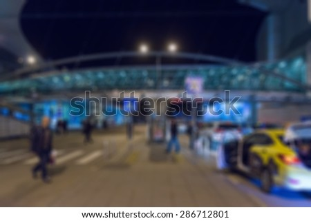 Modern airport at night abstract blur bokeh effect background - stock photo