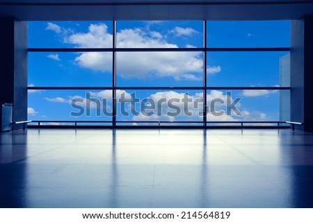 Modern airport interior glass wall aisle window - stock photo