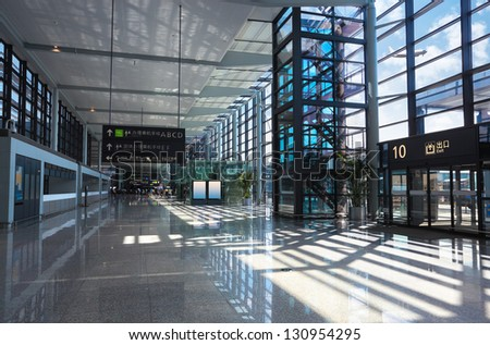 modern airport interior,terminal exit and flight in shanghai,China - stock photo