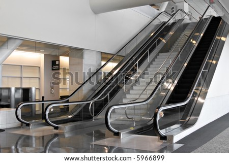 Modern Airport Interior with escalators - stock photo