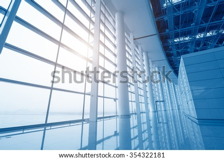 modern airport scene of passenger motion blur with window outside. - stock photo