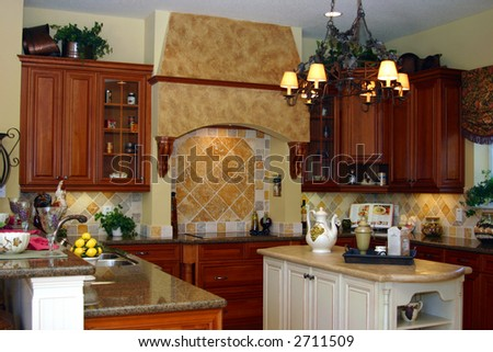 modern american kitchen with center island and breakfast bar - stock photo