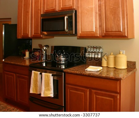 modern american kitchen with yellow and white highlights - stock photo