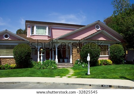 Modern american two-floored cottage with garden - stock photo