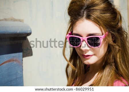 modern and attractive girl walking around the city - stock photo
