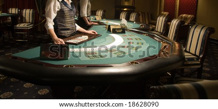 modern and beautiful casino interior, focus of poker playing tables - stock photo
