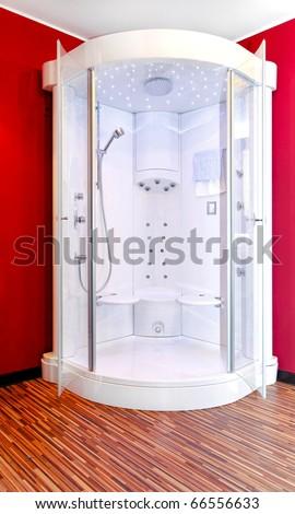 Modern and big shower cabin in bathroom corner - stock photo