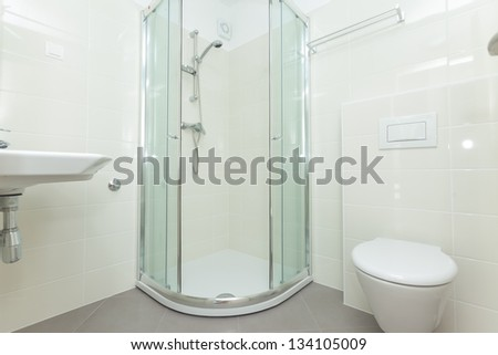 Modern and bright bathroom interior with shower - stock photo