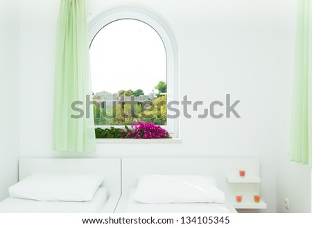 Modern and bright bedroom interior in mediterranean style - stock photo