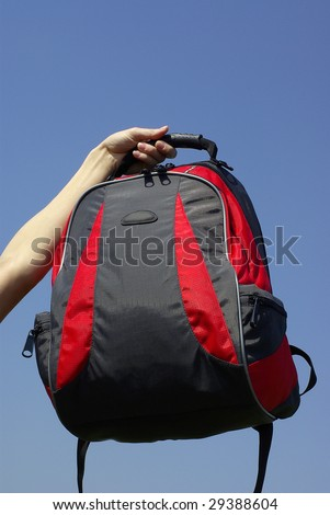 Modern and fashionable backpack in a hand