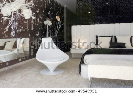 Modern and luxury decorated sleeping room (bedroom) - stock photo