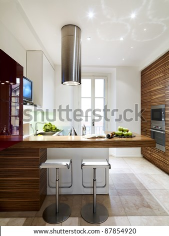 modern and luxury wood kitchen with two stool - stock photo