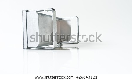 Modern and minimalistic design metal aluminium table desk on white empty background. Concept of smart futuristic office or study desk. Slightly de-focused and close-up shot. Copy space.