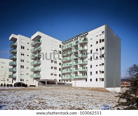 Modern and new apartment building in winter - stock photo